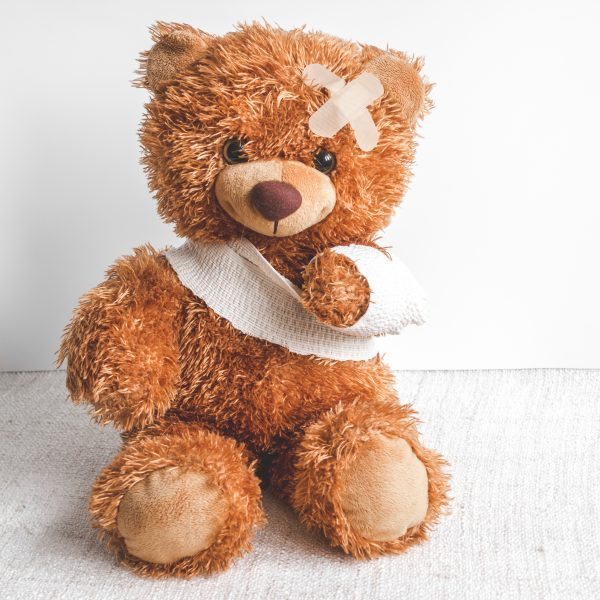 concept teddy bear childhood diseases at textile background close up